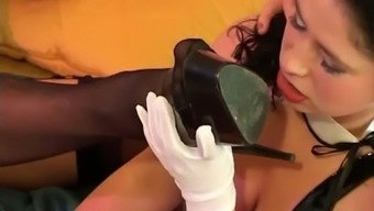 Dominatrix Has Her Two Female Slaves Licking Feet And Pussy