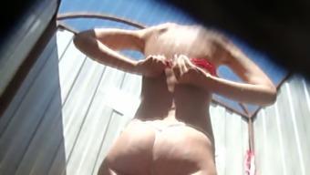 Slender White Caramel Skin Babe In The Beach Cabin Filmed Nude From Behind