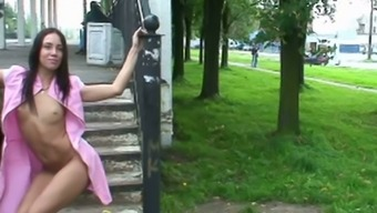 Fine And Sultry Lean Brunette Teen In Pink Dress Shows Her Goodies At The Train Station