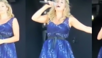 Wind Lifts Singer Dress Exposing Her Panties