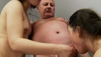 Kinky Old Man Has Two Adorable Girls Sharing His Cock And His Juices