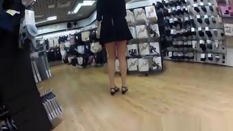 Woman In Black Dress Upskirted In Shopping Mall