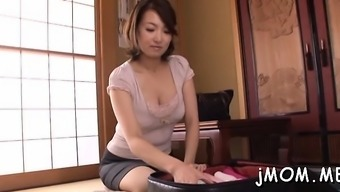 Amoral Japanese Older Licks Her Paramour All Over His Body