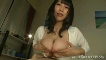 Lovely Yuuna Hoshisaki Gets Talked Into Jerking A Cock With Her Tits