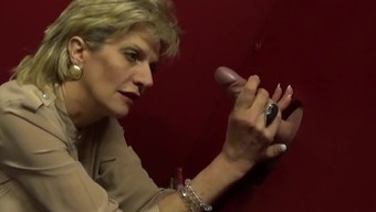 Busty Milf Female Sonia Milking A Large Dick Located On The Gloryhole