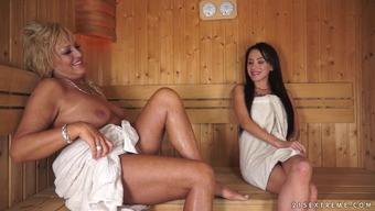 Cougar Rests A Young Adult Within The Sauna And Eat Her Soppy Pussy