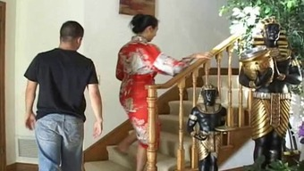 From Asia Milf Along With Large Titties Gives A Lucky Dude A Cheerful Handjob