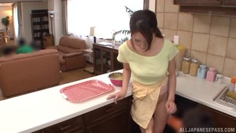 Topless And Busty Japanese Date Delivers A Couple Of Gentlemen In Her Kitchenette