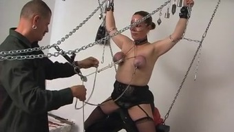 Large Weights Her Tits For The Orgasm