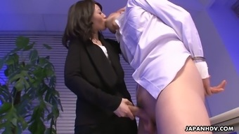 Sure Asian Nympho Mitsuki Gives Her Attractive Co-Worker A Very Nice Footjob