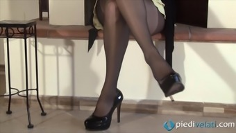 A Female In Nylons Flaunts Her Crazy Coloured Toes And Each Of Your Feet